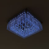 Chandelier crystal blue light on black wall Stock Photos