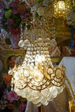 Chandelier with crystal pendants. In temple Stock Images