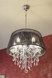 Chandelier with crystal pendants Stock Image