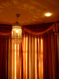 Chandelier Curtains. A beautiful chandelier with curtains Royalty Free Stock Images