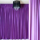 Chandelier and curtains. Black chandelier against a background of beautiful heavy colored curtains royalty free stock image