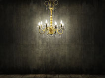 Chandelier in dark grungy concrete room Stock Image