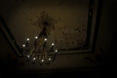 Chandelier in dark grungy concrete room Stock Image