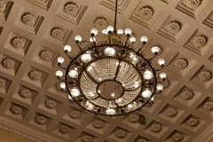 Chandelier on decoarted ceiling royalty free stock images