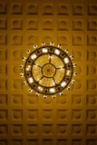 Chandelier on decoarted ceiling stock images