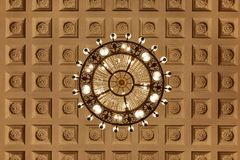 Chandelier on decoarted ceiling royalty free stock image
