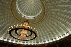 Chandelier and decorated ceiling Stock Photography