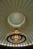 Chandelier and decorated ceiling. In a mosque royalty free stock image
