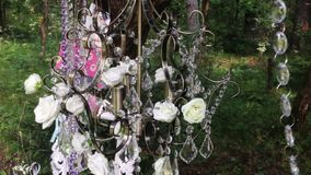 Chandelier with flowers in forest stock footage