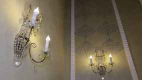 Chandelier in the form of candles on the wall. stock video