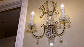 Chandelier in the form of candles on the wall. stock footage