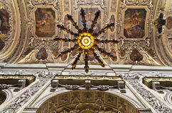 Chandelier, frescos and other beautiful decorations inside Dominican church in Vienna Stock Photos