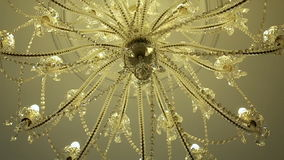 Chandelier of glass or crystal hanging inside stock video