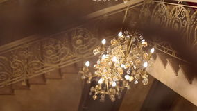 Chandelier in the hall. Solemn interior stock footage