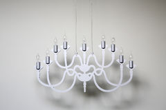 Chandelier hanging in bare room Stock Image