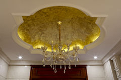 The chandelier hanging down from the golden roof Stock Photography