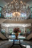 Chandelier hanging over lobby with stair and luxury hall. Chandelier hanging over  lobby with stair and luxury hall stock image