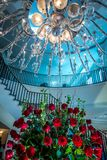 Chandelier hanging over lobby with stair and luxury hall. Chandelier hanging  over lobby with stair and luxury hall stock photo