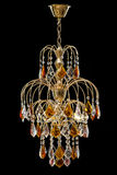Chandelier for interior of the living room. chandelier decorated with crystals and amber isolated on black background. Classic Chandelier for interior Stock Photography