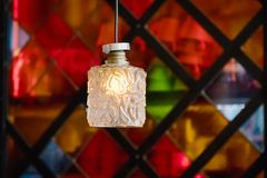 Chandelier light on a colored geometric background. Modern interior. Details royalty free stock photo