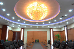 Chandelier in meeting room stock photos