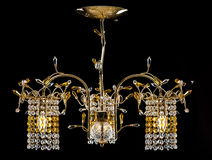 Chandelier for a modern interior. crystal chandelier for hallway, living room or bedroom. Isolated on black background. Chandelier for a modern interior. Gold Royalty Free Stock Photos