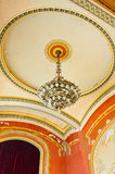 Chandelier and mural paint in theater hall Stock Images