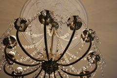 Chandelier in the museum. A beautiful chandelier in the Clocks museum in Lithuania Stock Image