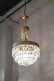 Chandelier. Old crystal chandelier hanging from ceiling Stock Photo