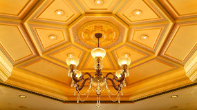 Chandelier on ornate ceiling stock photos