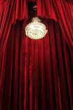 Chandelier with red curtains Royalty Free Stock Image
