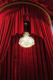 Chandelier with red curtains Stock Photo