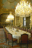 The Chandelier and Red Velvet Chairs in the Grand Salon of Napoleon III at the Louvre Museum, Paris, France Stock Image