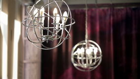 Chandelier in Romanesque style mainly carried out indoors stock video footage