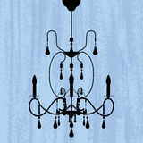 Chandelier on a scratched blue wallpaper Royalty Free Stock Photos