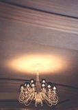 Chandelier shines on the ceiling Stock Photography