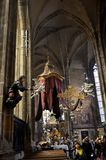 Sacred art objects inside the cathedral of Prague. Chandelier, statue, silver tomb and other sacred art objects in the cathedral of Prague royalty free stock photography