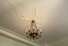 Chandelier and stucco Stock Photography