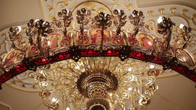 Chandelier in the temple stock video