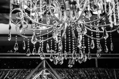 Chandelier with various hanging jewels  Stock Image