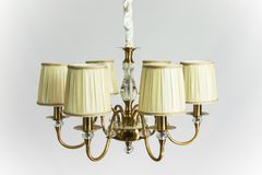 Golden Chandelier with Beige Plafonds. Chandelier vintage antique golden color with cloth plafonds Royalty Free Stock Photography