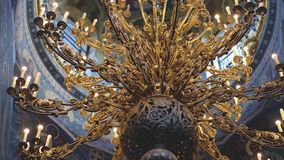 The chandeliers and the frescoes in the Church. Gorgeous and ancient iconostasis in the Cathedral of St. Petersburg. 4k. The chandeliers and the frescoes in the stock video footage