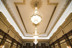 Chandeliers on ornate ceiling. Exquisite chandeliers on ornate ceiling stock photography