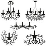 Chandeliers with a pattern on a ceiling, the burning candles in a candlestick, a black vector of lighting, design of a wall lamp, Stock Image