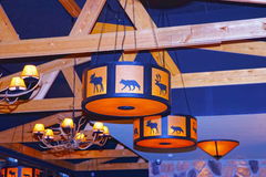 Chandeliers with reindeer horns and animals decor in a restauran Stock Images