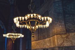 Chandeliers. Shot of beautiful chandeliers inside Aya Sofia in Istanbul Turkey Stock Photos