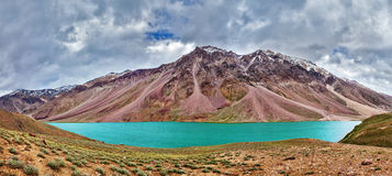 Chandra Tal lake in Himalayas. Panorama of mountain lake Chandra Tal in Himalayas. Himachal Pradesh, India Royalty Free Stock Photo