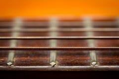 Chaîne de caractères de guitare Photographie stock