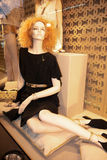 Chanel Fashion, Paris. A mannequin sitting in a window display. Printemps department store, Paris, France Royalty Free Stock Photos