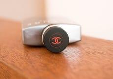 Geneva/Switzerland-19.08.18 :Chanel perfume logo men man cap wood stock photos